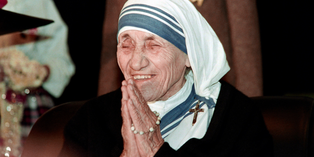 WEB3-MOTHER-TERESA-THERESA-PRAY-SMILE-AFP-000_F67YR